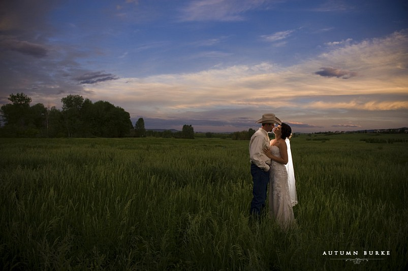 bride and groom at sunset at the botanic gardens at chatfield littleton colorado cowboy hat