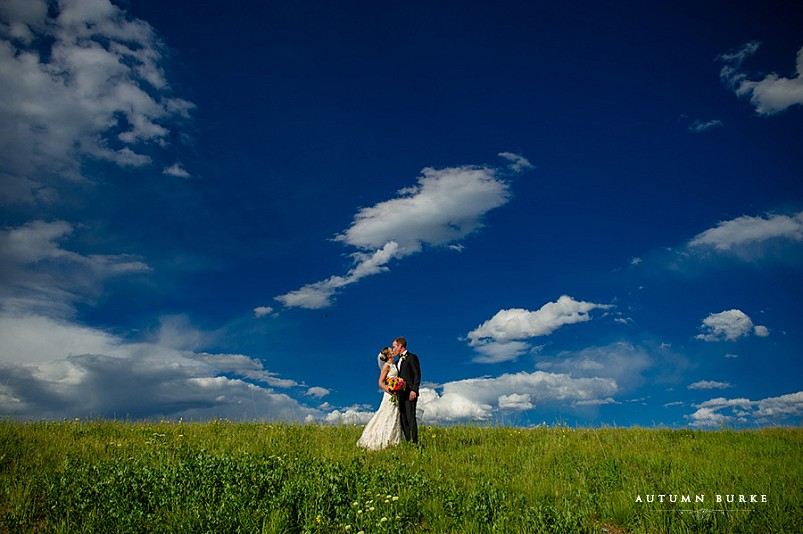 vail wedding deck bride and groom portrait bluebird skies