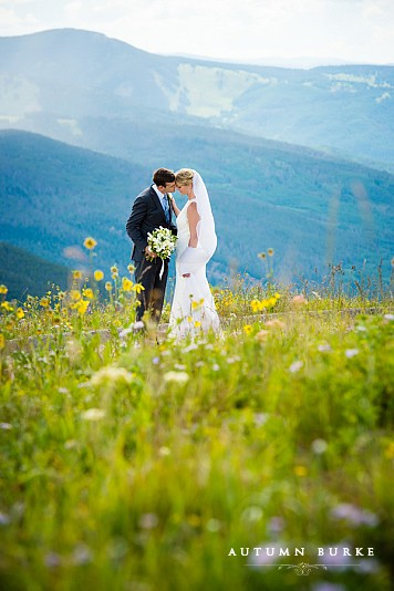 vail wedding deck bride and groom with mountains and wildflowers