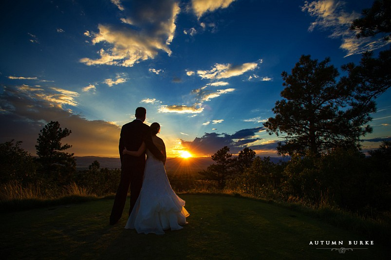 bride and groom silhouette sunset at the Sanctuary golf club sedlia colorado