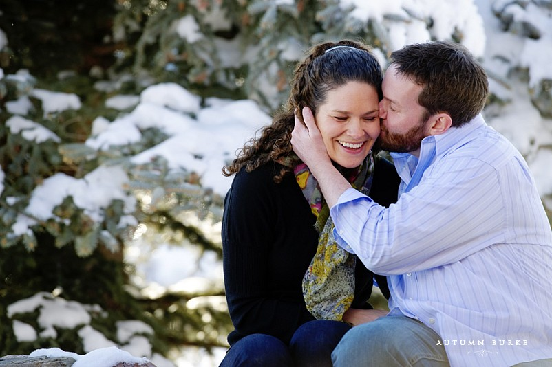 snowy engagement session, evergreen lake house, colorado winter engagement